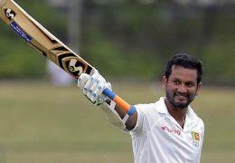 Sri Lanka's Dimuth Karunaratne raises his bat to celebrate scoring a century during the fourth day's play of their second cricket test match against India in Colombo, Sri Lanka, Sunday, Aug. 6, 2017. (AP Photo/Eranga Jayawardena)