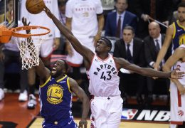 Toronto Raptors forward Pascal Siakam (43) blocks a shot by Golden State Warriors forward Draymond Green (23) during the second half of Game 1 of basketball's NBA Finals, Thursday, May 30, 2019, in Toronto. (Nathan Denette/The Canadian Press via AP) ORG XMIT: NSD135