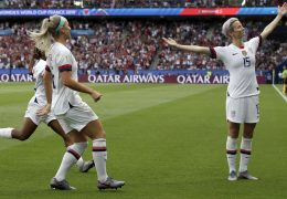 American player Megan Rapinoe, right, celebrates after scoring her team's first goal during the Women's World Cup quarterfinal soccer match between France and the United StatesFriday